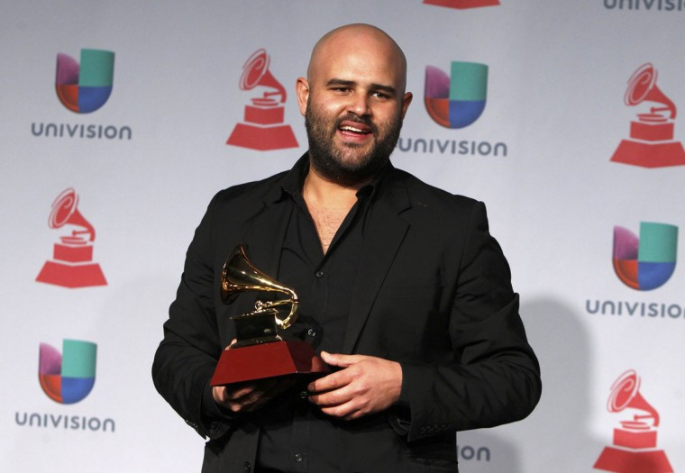 """Papayo poses backstage with his award for best urban performance for Pitbull's """"Echa Pa'lla"""", which featured his performance, during the 14th Latin Grammy Awards in Las Vegas. (REUTERS/Steve Marcus)"""
