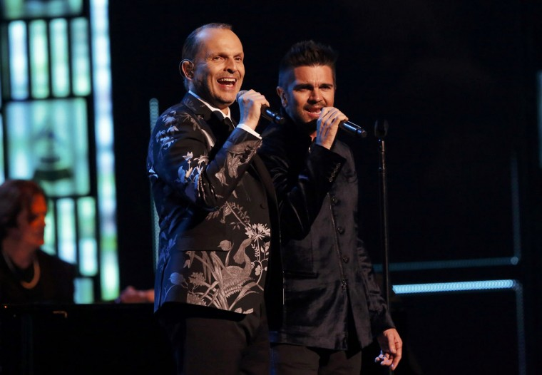 "Latin Recording Academy Person of the Year Miquel Bose, left, and Juanes perform ""Nada Particular"" during the 14th Latin Grammy Awards in Las Vegas. (REUTERS/Mario Anzuoni)"