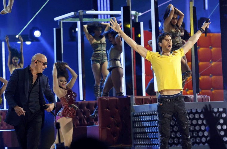 """Pitbull, left, and Enrique Igelsias perform """"Echa Pa'lla"""" during the 14th Latin Grammy Awards in Las Vegas. (REUTERS/Mario Anzuoni)"""