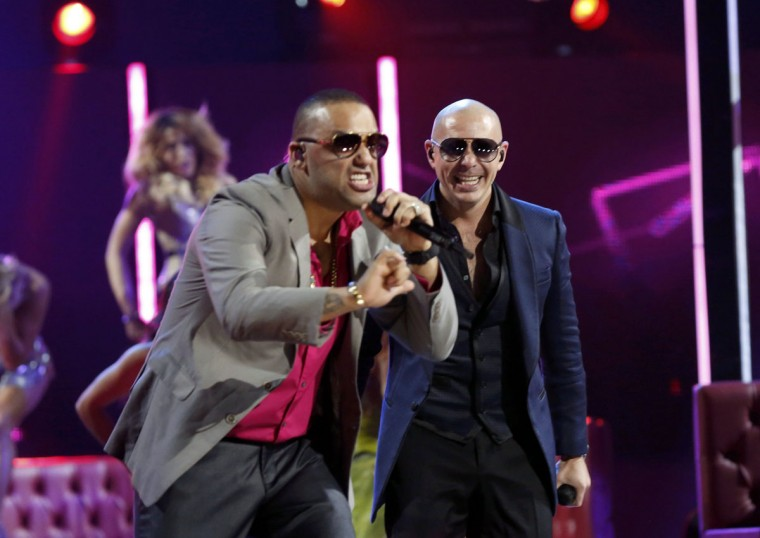 "El Cata, left, and Pitbull perform ""Echa Pa'lla"" during the 14th Latin Grammy Awards in Las Vegas. (REUTERS/Mario Anzuoni)"