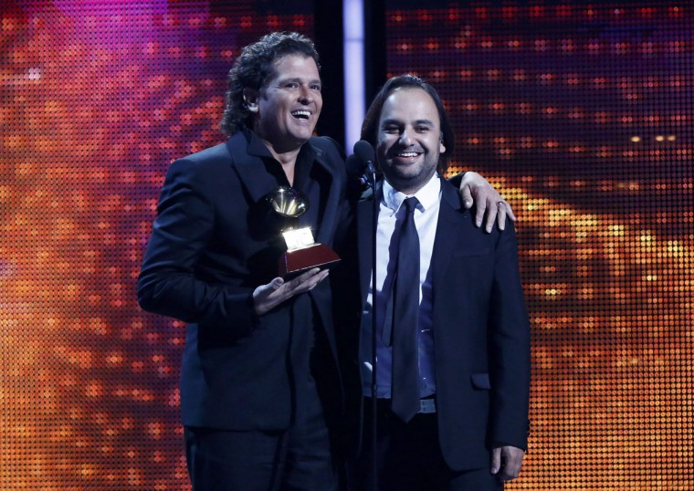 """Carlos Vive, left, and Andres Castro accept the Song of the Year award for """"Volvi a Nacer"""" during the 14th Latin Grammy Awards in Las Vegas. (REUTERS/Mario Anzuoni)"""