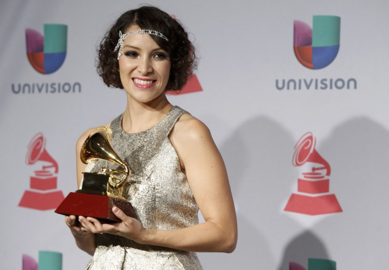 Gaby Moreno poses backstage with her award for best new artist during the 14th Latin Grammy Awards in Las Vegas. (REUTERS/Steve Marcus)