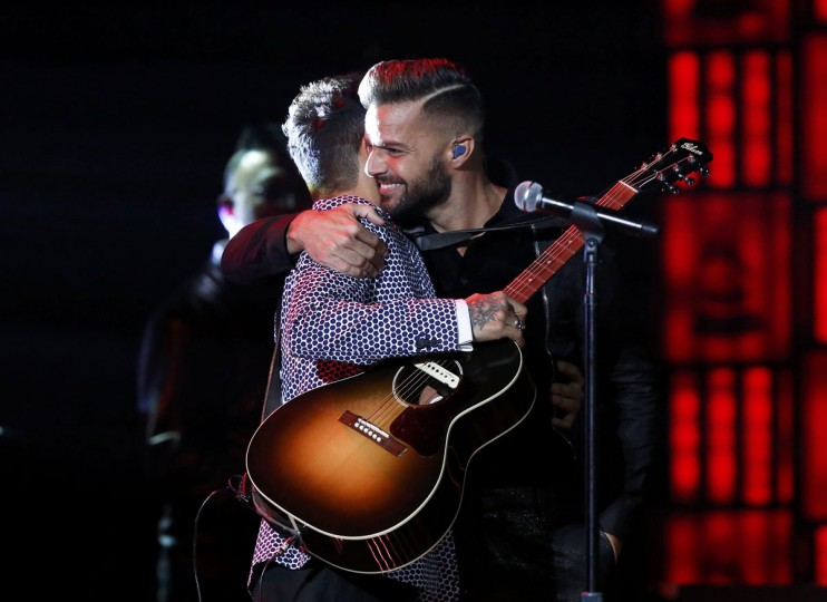 Draco, left, and Ricky Martin hug after performing Mas Y Mas during the 14th Latin Grammy Awards in Las Vegas. (REUTERS/Mario Anzuoni)