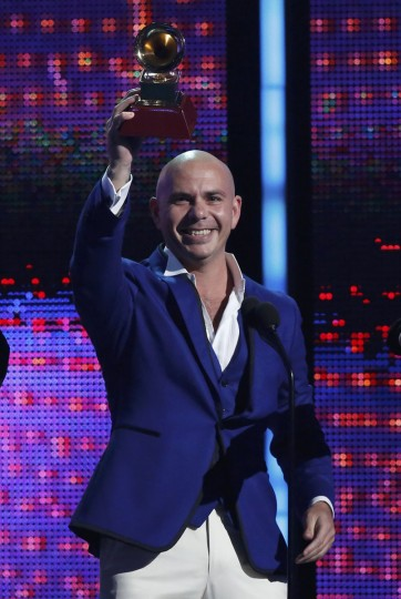"Pitbull accepts the Best Urban Peformance award for his song ""Echa Pa'lla"" featuring Papayo during the 14th Latin Grammy Awards in Las Vegas. (REUTERS/Mario Anzuoni)"