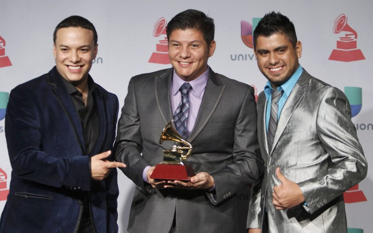 "La Original Banda El Lim N De Salvador Liz Rraga pose backstage with their Best Banda Album for ""La Original y Sus Boleros De Amor"" during the 14th Latin Grammy Awards in Las Vegas. (REUTERS/Steve Marcus)"