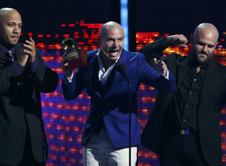 """Pitbull accepts the Best Urban Peformance award for his song """"Echa Pa'lla"""" featuring Papayo during the 14th Latin Grammy Awards in Las Vegas. (REUTERS/Mario Anzuoni)"""