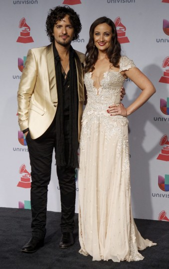 Tommy Torres and his wife Karla Monroig pose backstage during the 14th Latin Grammy Awards in Las Vegas. (REUTERS/Steve Marcus)
