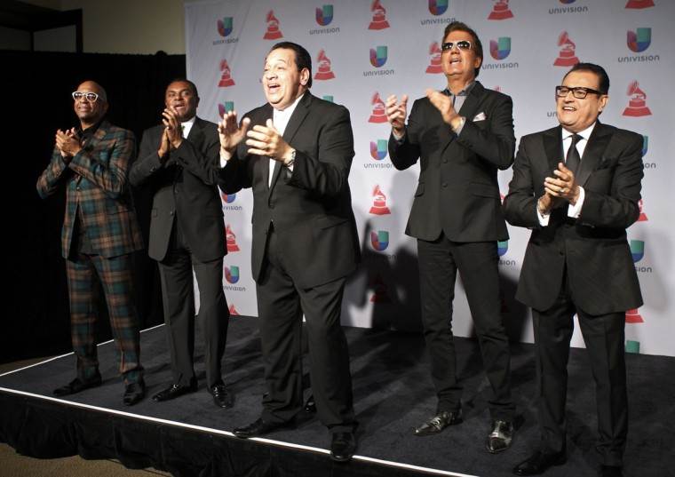 Sergio George, left, poses with members of Salsa Giants backstage during the 14th Latin Grammy Awards in Las Vegas. (REUTERS/Steve Marcus)