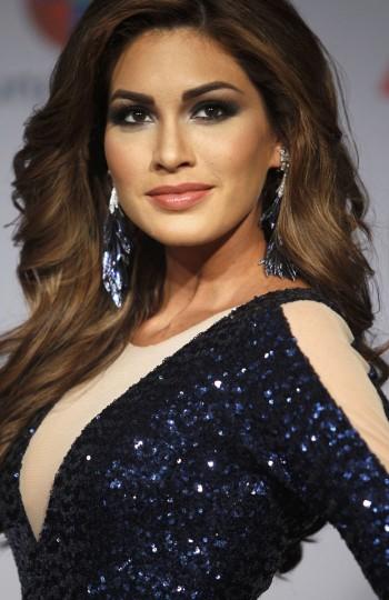 Miss Universe, Maria Gabriela Isler of Venezuela, poses backstage during the 14th Latin Grammy Awards in Las Vegas. (REUTERS/Steve Marcus)