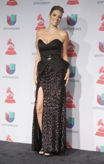 Laura Mayolo of Mojito Lite poses during the 14th Latin Grammy Awards in Las Vegas. (REUTERS/Steve Marcus)