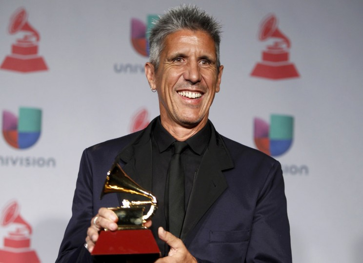 """Cachorro Lopez poses with his award for best rock song for """"Creo Que Me Enamore,"""" that he co-wrote with musician Vicentico (not pictured), backstage during the 14th Latin Grammy Awards in Las Vegas. (REUTERS/Steve Marcus)"""