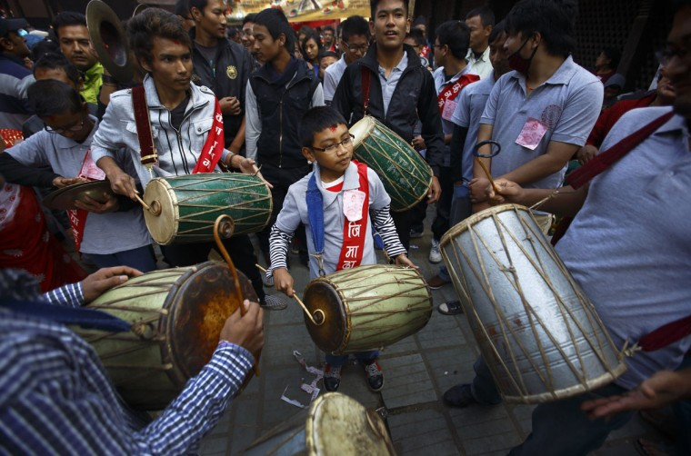 "Newari youths play traditional drums during the Newari New Year parade that falls during the Tihar festival also called Diwali in Kathmandu November 4, 2013. The Newar community in Nepal observes the start of their Newari New Year 1134, in accordance with their national lunar calendar, by worshipping their spiritual selves in a ritual known as ""mahapuja"". (Navesh Chitrakar/Reuters)"