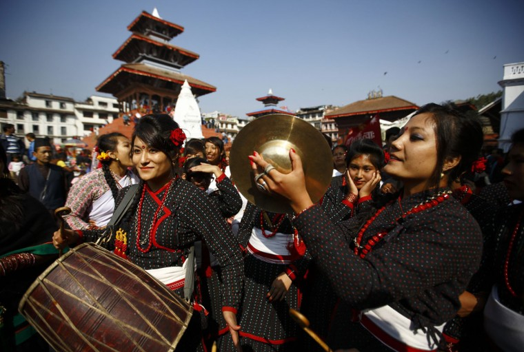 "Newari women in traditional attire play traditional instruments during the Newari New Year parade that falls during the Tihar festival also called Diwali in Kathmandu November 4, 2013. The Newar community in Nepal observes the start of their Newari New Year 1134, in accordance with their national lunar calendar, by worshipping their spiritual selves in a ritual known as ""mahapuja"". (Navesh Chitrakar/Retuers)"