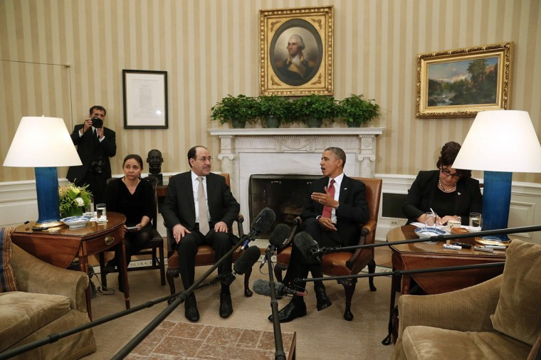 U.S. President Barack Obama (2nd R) and Iraq's Prime Minister Nuri al-Maliki (C) talk to reporters in the Oval Office after meeting at the White House in Washington, November 1, 2013. (REUTERS/Jonathan Ernst)