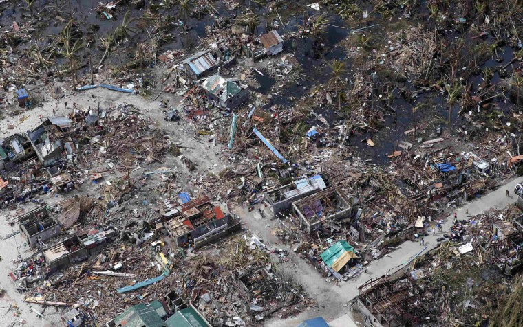 An aerial view of the devastation of super Typhoon Haiyan as it battered a town in Samar province in central Philippines November 11, 2013. Dazed survivors of a super typhoon that swept through the central Philippines killing an estimated 10,000 people begged for help and scavenged for food, water and medicine on Monday, threatening to overwhelm military and rescue resources. (Erik De Castro/Reuters)