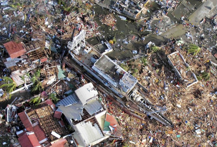 An aerial view of devastation and a ship after it was swept at the height of super typhoon Haiyan in Tacloban city in central Philippines November 9, 2013, in this handout provided by Philippine Air Force. (Lt Col Gaudie Lauron/Philippine Air Force)