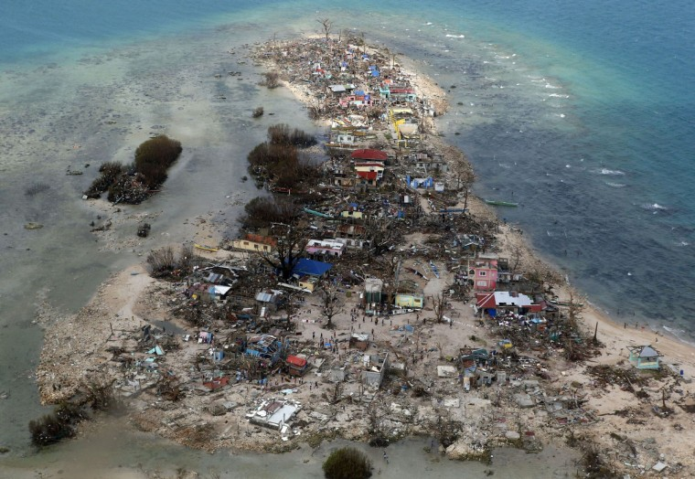 An aerial view of a coastal town, devastated by super Typhoon Haiyan, in Samar province in central Philippines November 11, 2013. Dazed survivors of super Typhoon Haiyan that swept through the central Philippines killing an estimated 10,000 people begged for help and scavenged for food, water and medicine on Monday, threatening to overwhelm military and rescue resources. (Erik De Castro/Reuters)