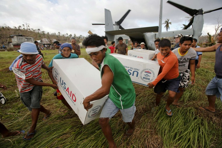 Filipinos carry boxes with aid from the U.S. relief organization US Aid after an Osprey aircraft of the U.S. Navy landed in a remote village near the eastern Samar town of Guiuan. Ten days after one of the most powerful typhoons ever recorded, some residents of remote villages in Eastern Samar province, where the storm made landfall in the central Philippines, said they were still waiting for aid. The Philippines is facing an enormous rebuilding task from Typhoon Haiyan, which killed at least 3,974 people and left 1,186 missing, with many isolated communities yet to receive significant aid despite a massive international relief effort. (Wolfgang Rattay/Reuters)