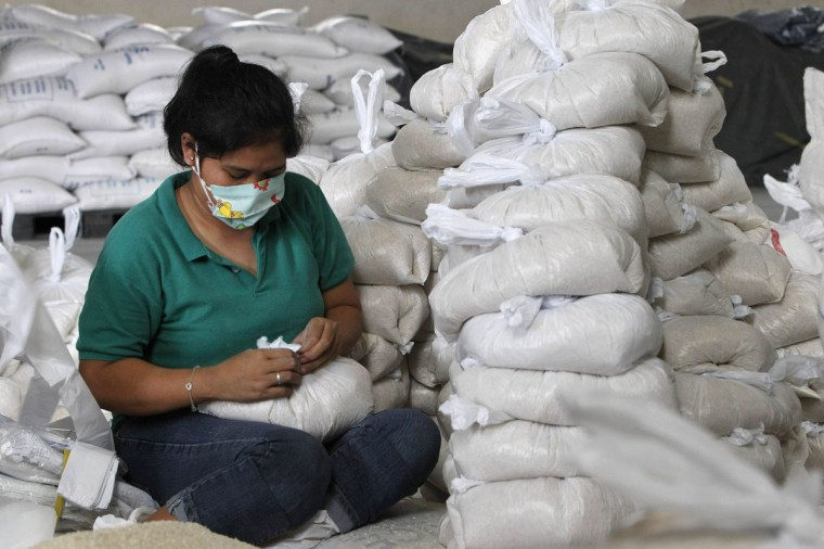 A volunteer packs rice inside a Department of Social Welfare and Development warehouse before shipping them out to the devastated provinces hit by Typhoon Haiyan. Typhoon Haiyan, the strongest typhoon in the world this year and possibly the most powerful ever to hit land battered the central Philippines on Friday. (ReutersRomeo Ranoco)
