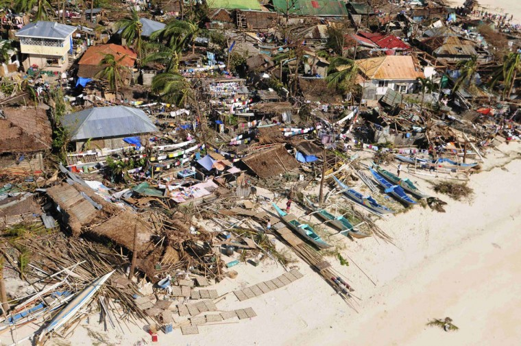 An aerial view shows damaged houses on a coastal community, after Typhoon Haiyan hit Iloilo Province, central Philippines November 9, 2013. One of the strongest typhoons ever to make landfall devastated the central Philippines, killing more than 1,000 people in one city alone and 200 in another province, the Red Cross estimated on Saturday, as reports of high casualties began to emerge. (Raul Banias/REUTERS)