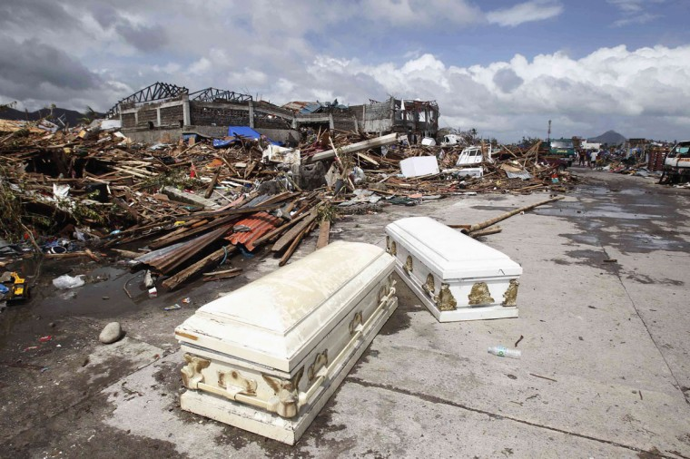 Empty coffins lie on a street near houses damaged after super Typhoon Haiyan battered Tacloban city, central Philippines November 10, 2013. One of the most powerful storms ever recorded killed at least 10,000 people in the central Philippines, a senior police official said on Sunday. (Romeo Ranoco/Reuters)