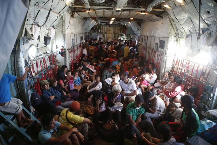 Typhoon survivors, waiting to leave the province of Leyte in the aftermath of the Super Typhoon Haiyan, are pictured in the hold of a C-130 military transport plane at Tacloban airport, in central Philippines, November 15, 2013. The death toll from the powerful typhoon that swept the central Philippines nearly doubled overnight, reaching 4,000, as helicopters from a U.S. aircraft carrier and other naval ships began flying food, water and medical teams to ravaged regions. (Erik De Castro/REUTERS)