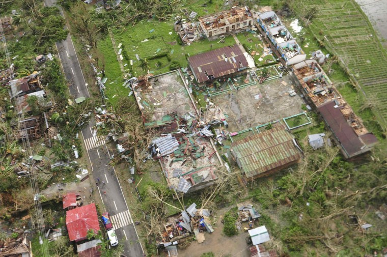 An aerial view shows damaged houses after Typhoon Haiyan hit Iloilo Province, central Philippines November 9, 2013. One of the strongest typhoons ever to make landfall devastated the central Philippines, killing more than 1,000 people in one city alone and 200 in another province, the Red Cross estimated on Saturday, as reports of high casualties began to emerge. (Raul Banias/REUTERS)