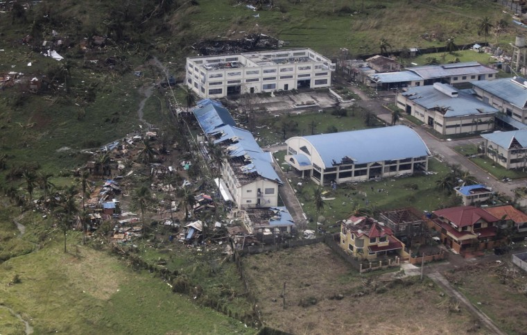 An aerial view shows damages caused by Typhoon Haiya after hitting Leyte province, central Philippines November 10, 2013. One of the most powerful storms ever recorded killed at least 10,000 people in the central Philippines, a senior police official said on Sunday, with huge waves sweeping away coastal villages and devastating one of the main cities in the region. (Ryan Lim/Malacanang Photo Bureau/Handout via Reuters)