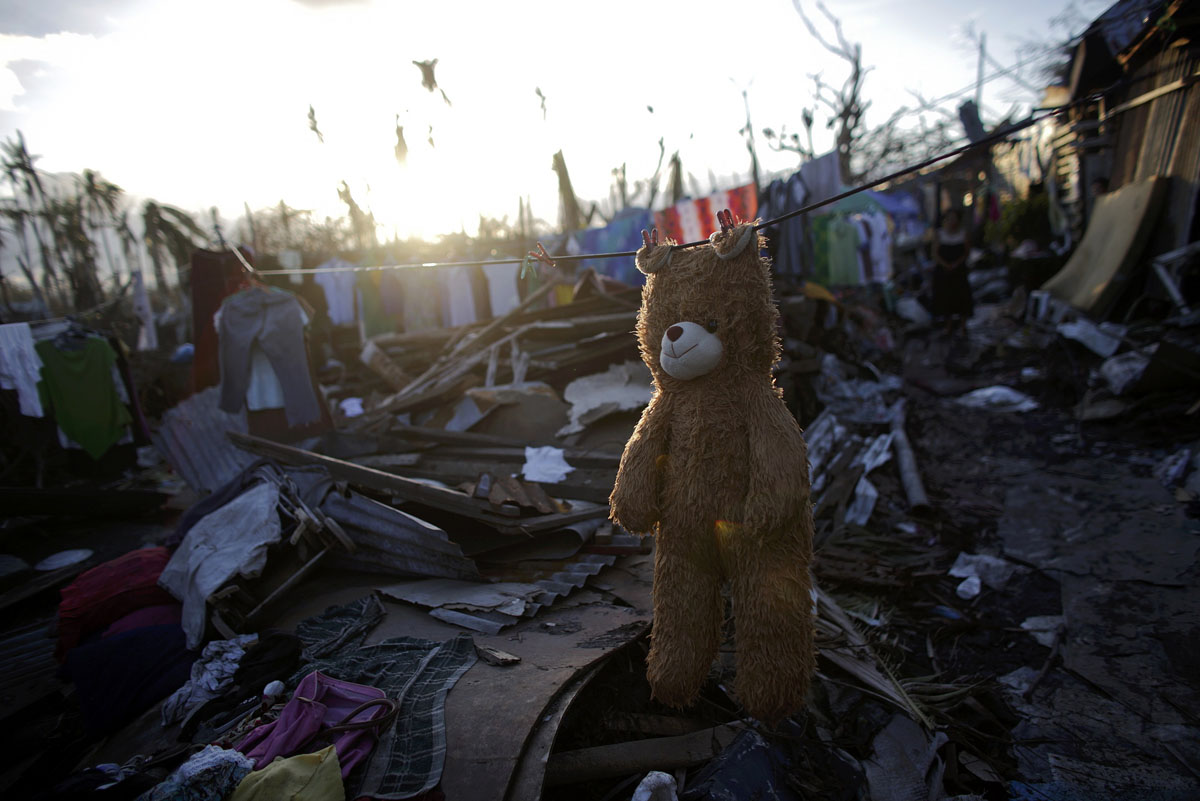 A teddy bear is hung out to dry in a part of Tolosa devastated by Typhoon Haiyan, November 16, 2013. Long-delayed emergency supplies flowed into the typhoon-ravaged central Philippines on Saturday, reaching desperate families who had to fend for themselves for days, as the United Nations more than doubled its estimate of homeless to nearly two million. (John Javellana/REUTERS)