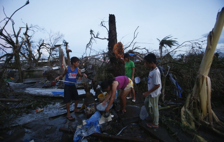 Residents fetch water from an artesian well after super Typhoon Haiyan battered Tacloban city in central Philippines November 9, 2013. Possibly the strongest typhoon ever to hit land devastated the central Philippine city of Tacloban, killing at least 100 people, turning houses into rubble and leveling the airport in a surge of flood water and high wind, officials said on Saturday. The toll of death and damage from Typhoon Haiyan on Friday is expected to rise sharply as rescue workers and soldiers reach areas cut off by the massive, fast-moving storm which weakened to a category 4 on Saturday. (Erik De Castro /REUTERS)