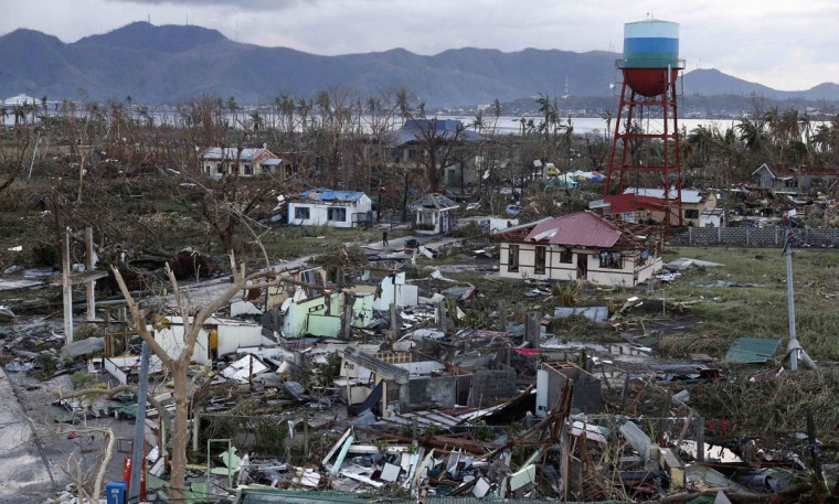 A view of destroyed houses after super Typhoon Haiyan battered Tacloban city in central Philippines November 9, 2013. Possibly the strongest typhoon ever to hit land devastated the central Philippine city of Tacloban, killing at least 100 people, turning houses into rubble and leveling the airport in a surge of flood water and high wind, officials said on Saturday. The toll of death and damage from Typhoon Haiyan on Friday is expected to rise sharply as rescue workers and soldiers reach areas cut off by the massive, fast-moving storm which weakened to a category 4 on Saturday. (Erik De Castro/REUTERS)