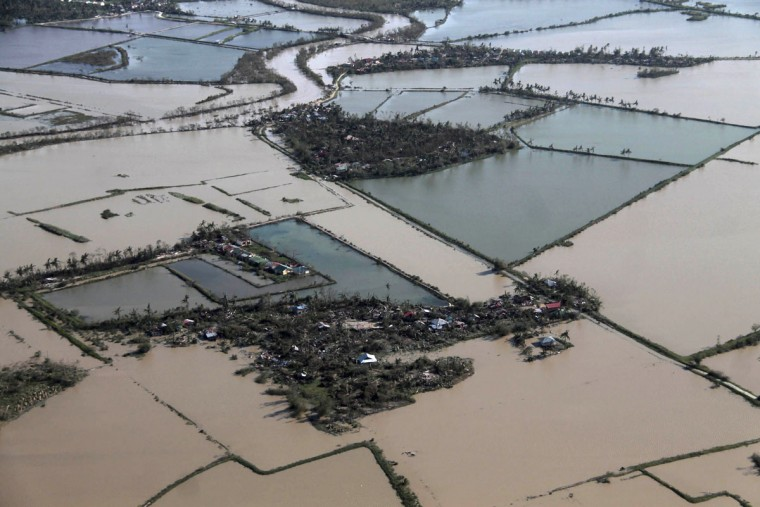 An aerial view shows flooded rice fields after Typhoon Haiyan hit Iloilo Province, central Philippines November 9, 2013. One of the strongest typhoons ever to make landfall devastated the central Philippines, killing more than 1,000 people in one city alone and 200 in another province, the Red Cross estimated on Saturday, as reports of high casualties began to emerge. (Leo Solinap/REUTERS)