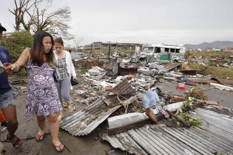 A pregnant woman walks past debris left by super Typhoon Haiyan after it battered Tacloban city, central Philippines November 9, 2013. Typhoon Haiyan, the strongest typhoon in the world this year and possibly the most powerful ever to hit land battered the central Philippines on Friday, forcing millions of people to flee to safer ground, cutting power lines and blowing apart houses. Haiyan, a category-5 super typhoon, bore down on the northern tip of Cebu Province, a popular tourist destination with the country's second-largest city, after lashing the islands of Leyte and Samar with 275 kph (170 mph) wind gusts and 5-6 meter (15-19 ft) waves. (Romeo Ranoco/REUTERS)