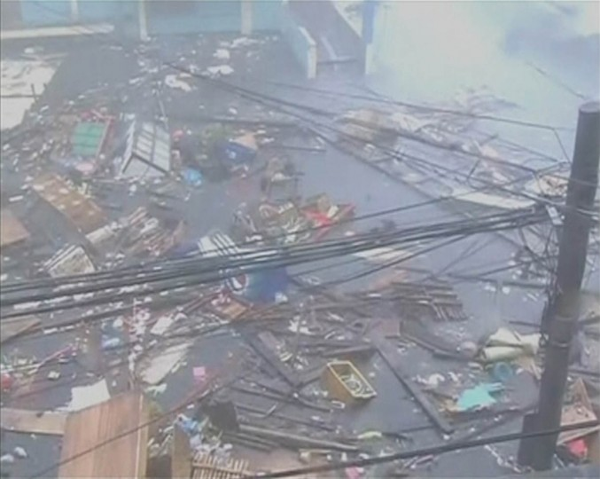 Debris floats on a flooded road as strong winds and rain continue to batter buildings after Typhoon Haiyan hit Tacloban city, Leyte province in this still image from video November 8, 2013. Haiyan, potentially the strongest recorded typhoon to make landfall, slammed into the Philippines' central islands on Friday, forcing millions of people to flee to safer ground or take refuge in storm shelters. The category-five super typhoon whipped up giant waves as high as 4-5 metres (12-15 feet) that lashed the islands of Leyte and Samar, and was on track to carve a path through popular holiday destinations. (Reuters)