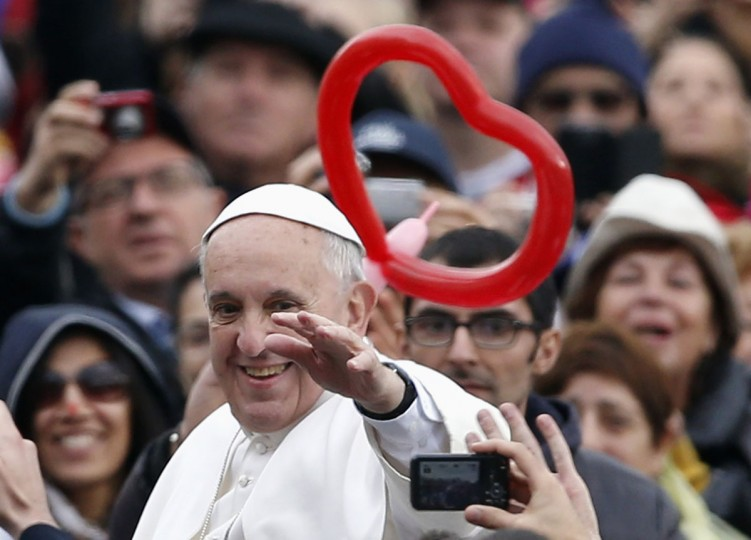 Pope Francis waves as he arrives to conduct his weekly general audience at St. Peter's Square at the Vatican November 20, 2013. (Stefano Rellandini/REUTERS)