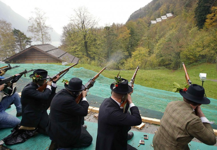 Participants fire their old infantry rifles during the traditional 'Ruetlischiessen' (Ruetli shooting) competition at the Ruetli meadow in central Switzerland. One thousand, one hundred and fifty two participants took part in the annual shooting event, a tradition since 1860, over a distance of 300 metres (984 ft). (Arnd Wiegmann/Reuters)