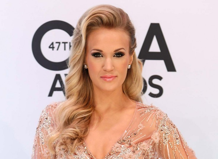 "A new version of the classic musical ""The Sound of Music,"" is set for U.S. television next week and American country singer Carrie Underwood will star as the aspiring nun who brings song into the home of a strict Austrian widower. Reuters file photo by Eric Henderson"