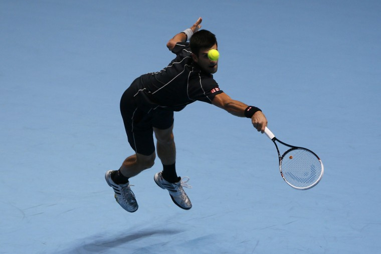 Novak Djokovic of Serbia hits a return during his men's singles tennis match against Juan Martin del Potro of Argentina at the ATP World Tour Finals at the O2 Arena in London November 7, 2013. (Stefan Wermuth/REUTERS)