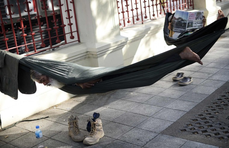 Anti-government protesters sleep as they take a break from demonstrations in central Bangkok November 29, 2013. Thousands of protesters took to the streets in the latest escalation in country-wide demonstrations seeking to topple Prime Minister Yingluck Shinawatra. (Dylan Martinez/REUTERS)