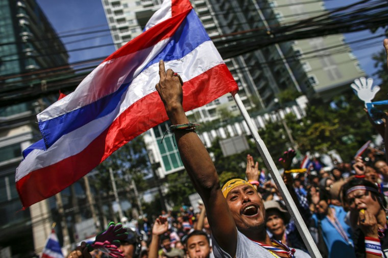An anti-government protester gestures as he gathers with others outside the headquarters of the ruling Puea Thai Party of Prime Minister Yingluck Shinawatra in Bangkok November 29, 2013. (Athit Perawongmetha/REUTERS)