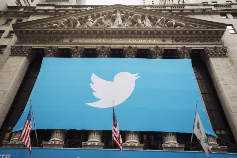 A sign displays the Twitter logo on the front of the New York Stock Exchange ahead of the company's IPO in New York, November 7, 2013. Twitter Inc could face volatile trade in its debut Thursday on the New York Stock Exchange, analysts said, but they remained enthusiastic after the money-losing social media company priced its IPO above the expected range. The microblogging network priced 70 million shares at $26 on Wednesday evening, above the targeted range of $23 to $25, which had been raised once before. The IPO values Twitter at $14.1 billion (8.8 billion pounds), with the potential to reach $14.4 billion if underwriters exercise an over-allotment option. (Lucas Jackson/REUTERS)