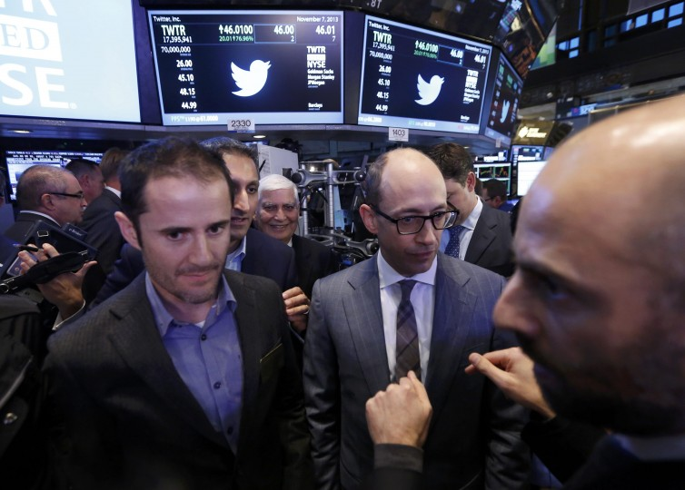 Twitter CEO Dick Costolo (C) stands with co-founder Evan Williams after the Twitter Inc. IPO on the floor of the New York Stock Exchange in New York, November 7, 2013. (Brendan McDermid/REUTERS)