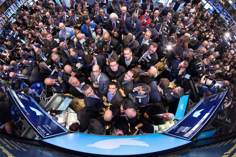 Twitter CEO Dick Costolo (C) stands on the floor of the New York Stock Exchange before Twitter stock goes on sale in New York November 7, 2013. Twitter Inc could face volatile trade in its debut Thursday on the New York Stock Exchange, analysts said, but they remained enthusiastic after the money-losing social media company priced its IPO above the expected range. (REUTERS)