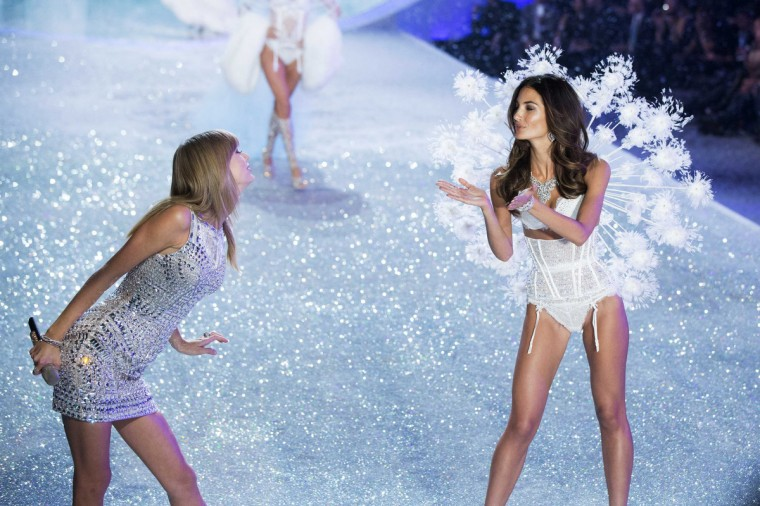 Singer Taylor Swift gestures towards Lily Aldridge (R) as she presents a creation during the annual Victoria's Secret Fashion Show in New York November 13, 2013. (Lucas Jackson/Reuters)