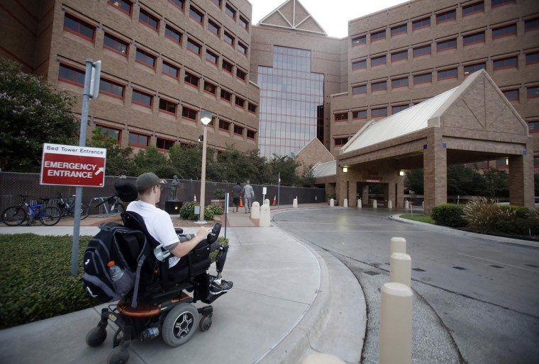 Sgt. Matt Krumwiede of the U.S. Army makes his way to Brooke Army Medical Center in San Antonio, Texas August 1, 2013. (Jim Urquhart/Reuters)
