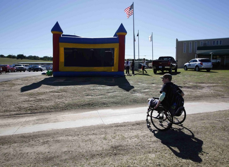 Sgt. Matt Krumwiede of the U.S. Army wheels himself in his wheelchair during a skeet shooting event at the National Shooting Complex in San Antonio, Texas November 2, 2013. (Jim Urquhart/Reuters)