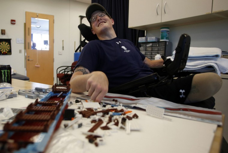 Sgt. Matt Krumwiede of the U.S. Army assembles a Lego set during occupational therapy at the Center for the Intrepid at Brooke Army Medical Center in San Antonio, Texas August 1, 2013. (Jim Urquhart/Reuters)