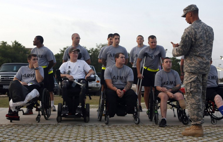 Sgt. Matt Krumwiede of the U.S. Army (front, 2nd L) lines up for morning formation at Brooke Army Medical Center in San Antonio, Texas August 1, 2013. (Jim Urquhart/Reuters)