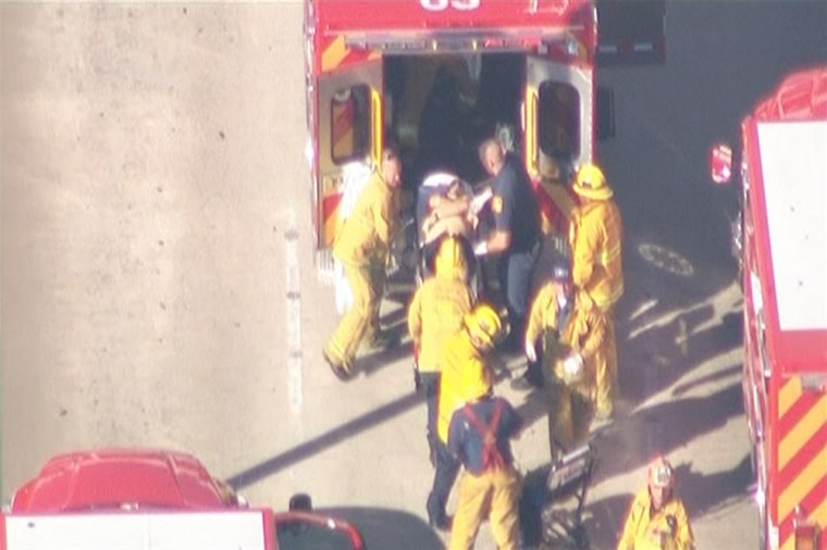 Firefighters load a person on a stretcher into an ambulance during an incident in which shots were fired at Los Angeles International Airport in Los Angeles November 1, 2013.(KNBC/Reuters)