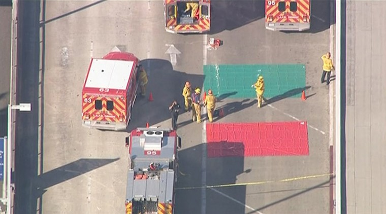 Firefighters set up a triage area during an incident in which shots were fired at Los Angeles International Airport in Los Angeles in this still image taken from video provided by KNBC November 1, 2013. Passengers were evacuated from the terminal during the incident. Authorities were responding to a shooting incident with multiple injuries at the Los Angeles International Airport on Friday, and California media reported that a gunman with a high-powered rifle was shot by law enforcement. (KNBC/Reuters)
